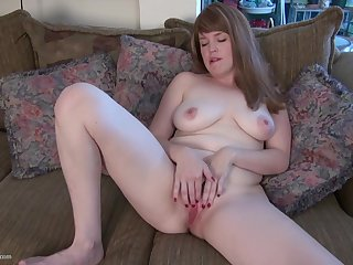 Lisa J. exposes her huge natural tits and masturbates with a dildo