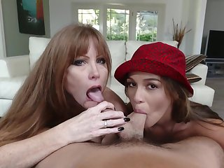 Milf joins a young couple for a BJ trio