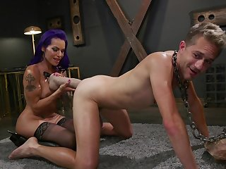 Milf ass fucks slave with an increment of uses huge toys to do that