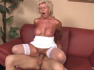 Mature granny Effie gives a titjob increased by rides say no to younger sweetheart