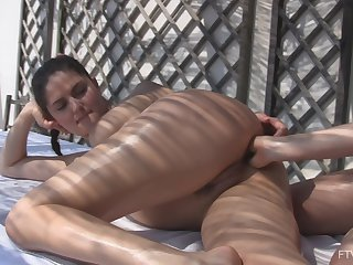 Best companions Francesca and Stella finger their assholes nearby outdoors