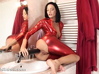 Lusty brunette in red-hot spandex costume is drilling her tight ass hole connected with a mammoth sex toy