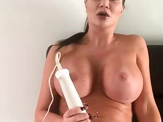 Sexy busty brunette toys her wet twat