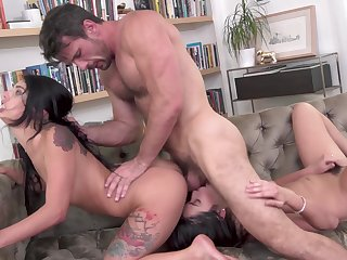Muscular man fucks both these hungry girls in a crazy motion